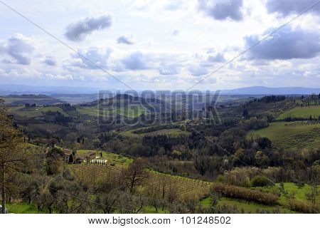 Tuscany Wild Landscape With Field, Groove, Moody Sky. Italy