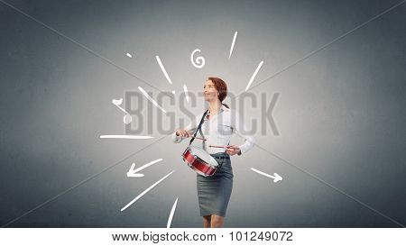 Young businesswoman on color background playing drums