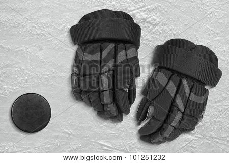 Puck And Hockey Gloves