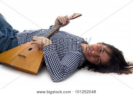 Lying young man with balalaika