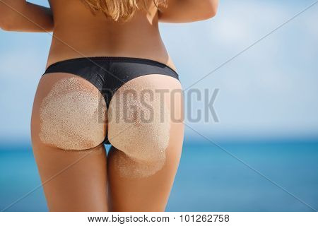 Sexy ass women with beautiful shape on the beach.