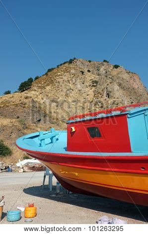 Colorful fishing boat on dry land