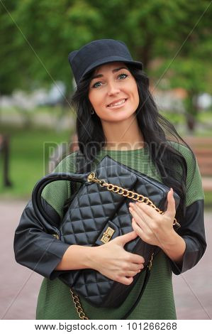 girl in a hat with ears, holding a bag on the street