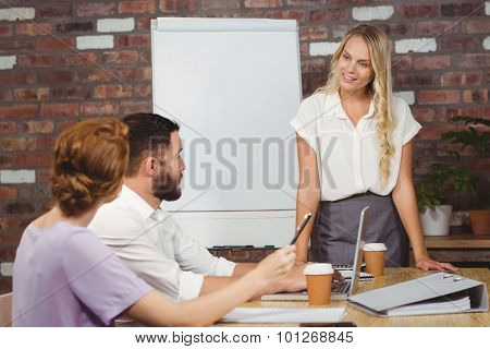 Businesswoman briefing over conference table in office