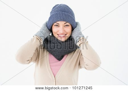 Smiling brunette wearing warm clothes on white background