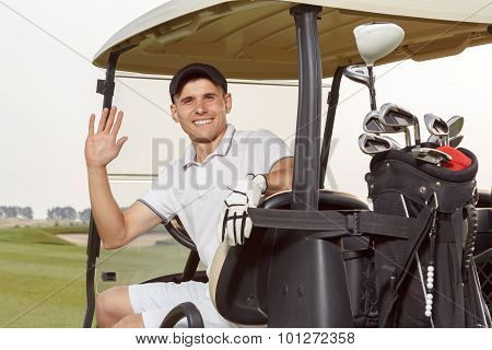 Golfer in golfcart with his clubs on the back