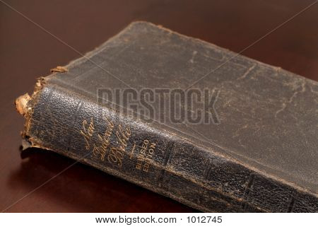 Close Up View Of A Very Old Family Bible Resting On Table