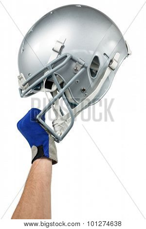 Cropped image of American football player handing his helmet on a white background