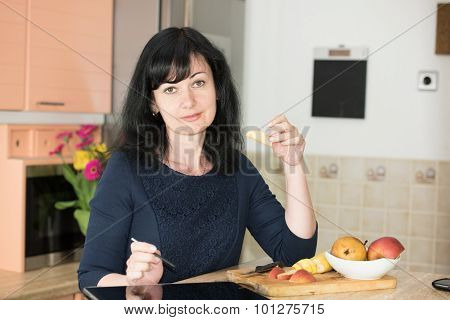 Woman In The Kitchen With Tablet