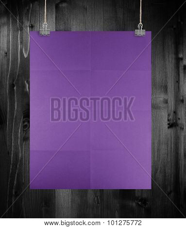 Purple Poster On A Wood Wall.