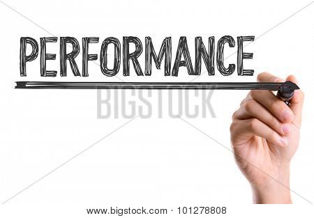 Hand with marker writing the word Performance