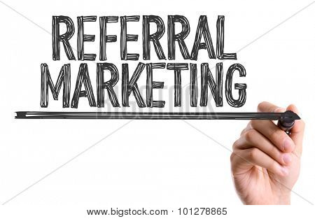 Hand with marker writing the text Referral Marketing