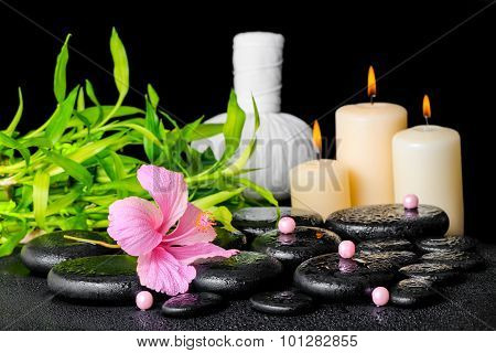 Spa Composition Of Hibiscus Flower, Bamboo, Thai Herbal Compress Ball, Beads And Candles On Zen Basa