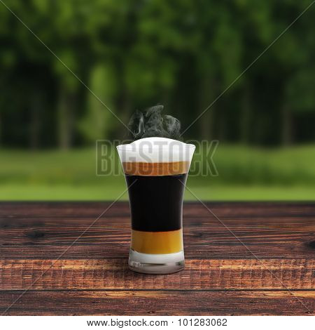 Mocha Coffee On Wooden Table Around Tree