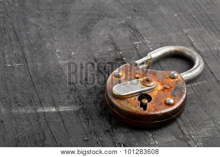 Open Antique Padlock On Black