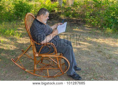 Senior man doing sketch
