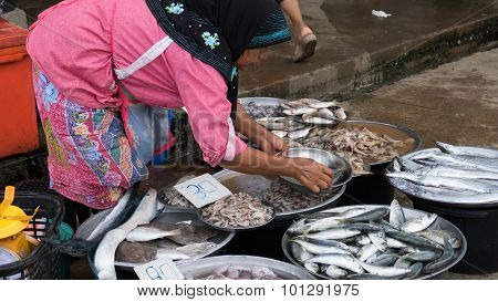 Woman Sell Seafood In The Local Market