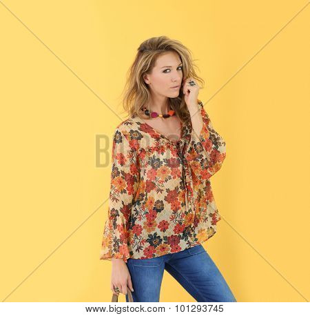 Beautiful trendy woman, isolated on yellow background