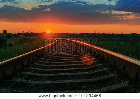 low red sun on sunset over railway