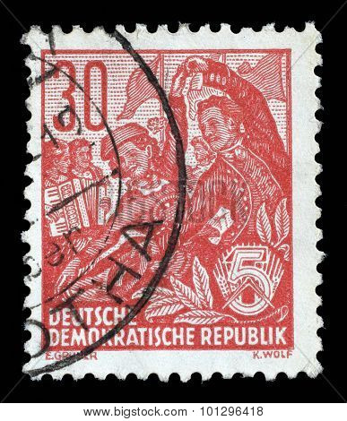 GDR - CIRCA 1953: A stamp printed in GDR, shows a Folk dance group, series Five-year plan, circa 1953