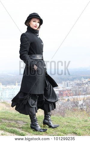 Goth girl standing on a hill