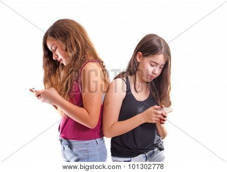 Friends Chatting And Texting On Their Phones