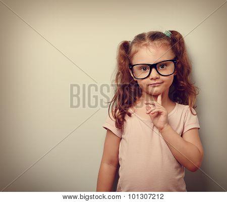Thinking Cute Kid Girl Looking Confident In Eyeglasses. Vintage Portrait