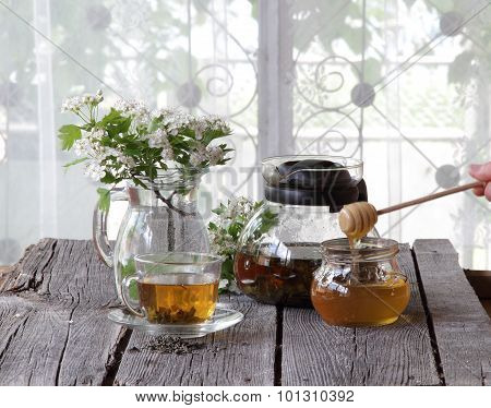 Green Tea In A Transparent Cup, Honey In A Glass Jar And A Branch Of A Hawthorn With Colours