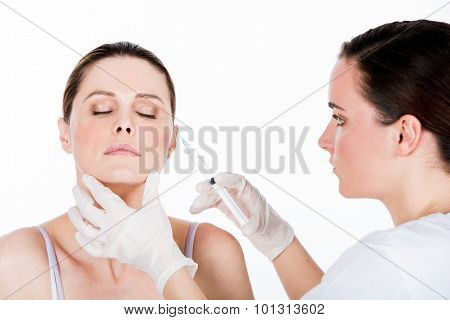 Doctor Gets botox injection to a woman patient