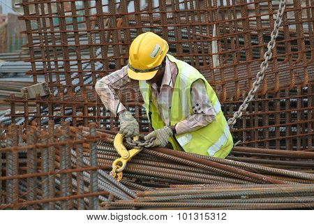 A construction worker hoisting the steel reinforcement bar