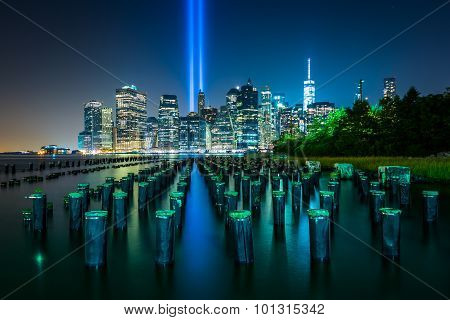 Pier Pilings And The Tribute In Light Over The Manhattan Skyline At Night, Seen From Brooklyn Bridge