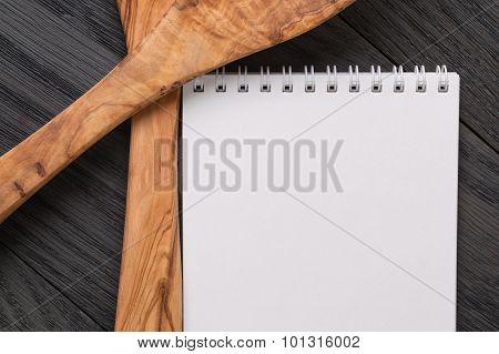 simple blank notepad on rustic wood table