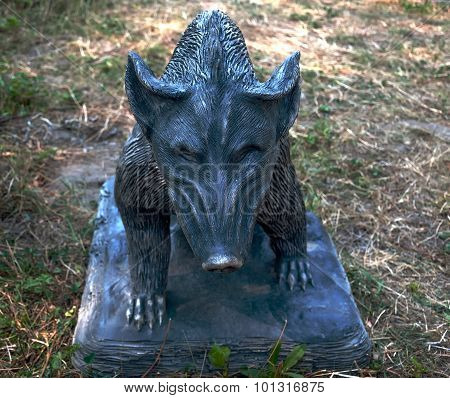 Sculpture Of A Wild Boar On The Ground