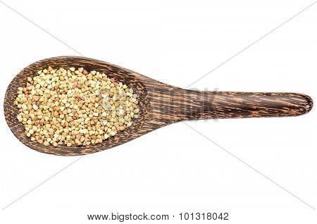 gluten free buckwheat pseudograin  on a wooden spoon isolated on white