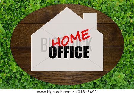 Home office written on wooden background