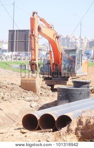 excavator works at a construction