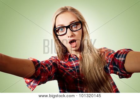 Close Up Portrait Of A Young Surprised Blonde Girl Holding A Sma