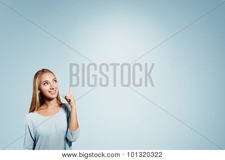 Business Woman Pointing Showing And Looking To The Side Up At Empty Copyspace. Caucasian Female Busi