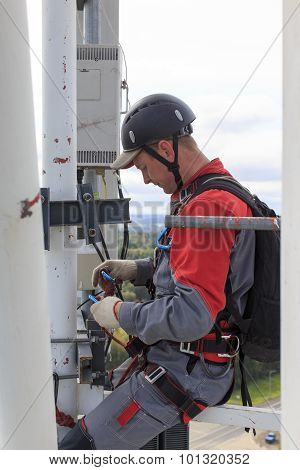industrial climber on a cellular tower