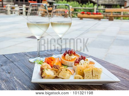Tasty finger food on a wooden table.