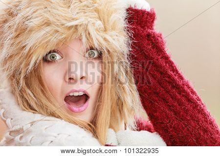 Scared Pretty Fashion Woman In Fur Winter Hat