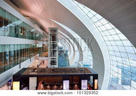 DUBAI, UAE - JUNE 23, 2015: airport interior. Dubai International Airport is a major international airport located in Dubai, and is the world's busiest airport by international passenger traffic.