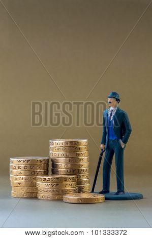 Single Business Man Miniature Model And English One Pound Coins