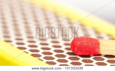 Macro Close Up Of A Red Match Head