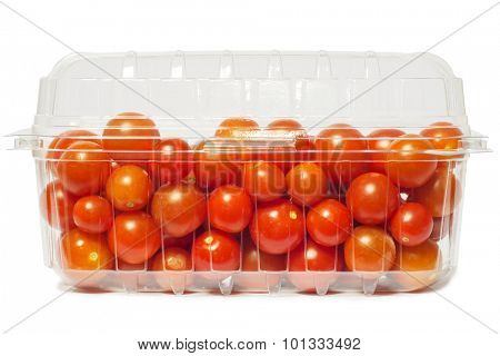 Cherry tomato in plastic package, studio isolated on white