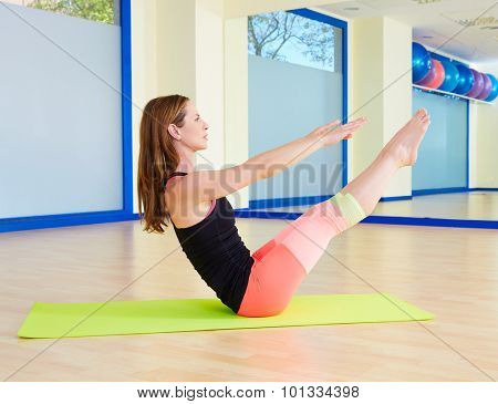 Pilates woman teaser exercise workout at gym indoor