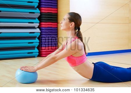 Pilates woman stability ball swan exercise workout at gym indoor