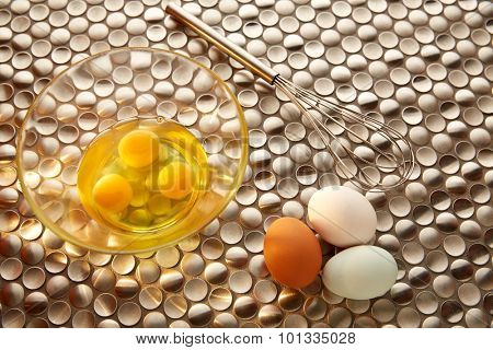 Eggs and shaker with blue easter white and brown egg colors on modern stainless steel