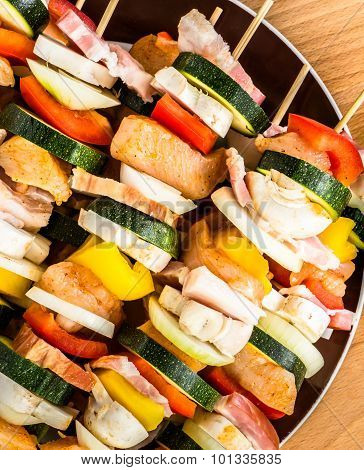 Skewers With Chicken, Bacon And Vegetables Prepared For Barbecue Grill.