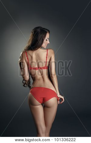 Advertising underwear. Model posing back to camera
